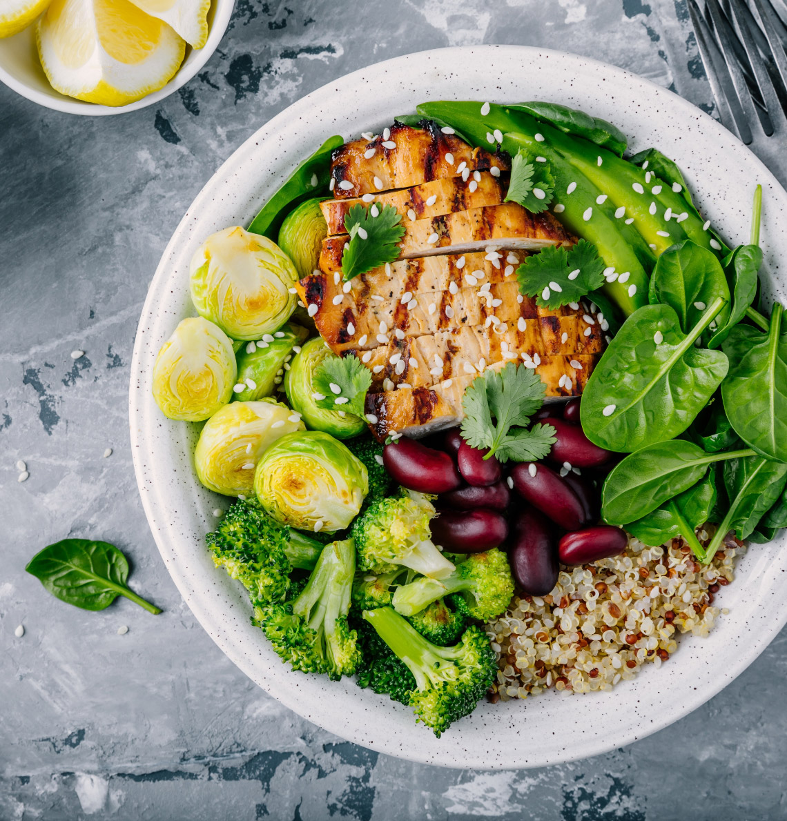 Vegetable bowl with quinoa, beans, and grilled chicken