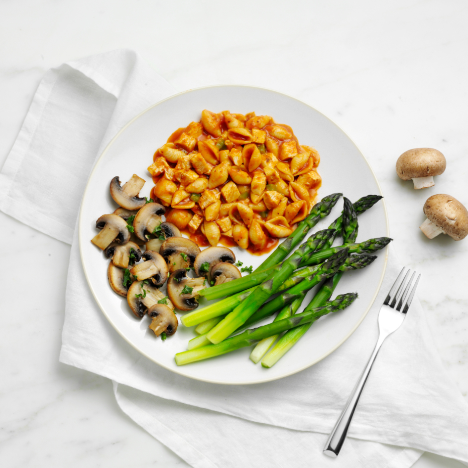 HMR Chicken Pasta Parmesan prepared with cooked mushrooms and asparagus