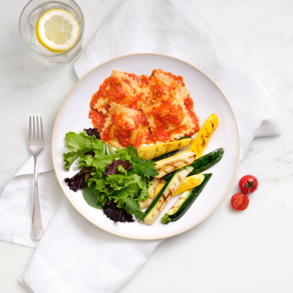 HMR Cheese and Basil Ravioli with Tomato Sauce prepared with salad and cooked vegetables